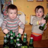 Babies with Beer Bottles Picture Caption